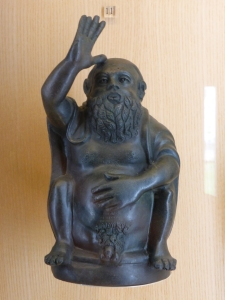 Buddha-like satyr giving the bird