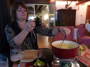 Margo taking a picture of Swiss fondue